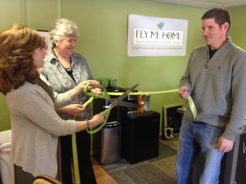 Susan Guzik cuts the ribbon of her new small business, Fly Me Home, in Hughestown, PA.